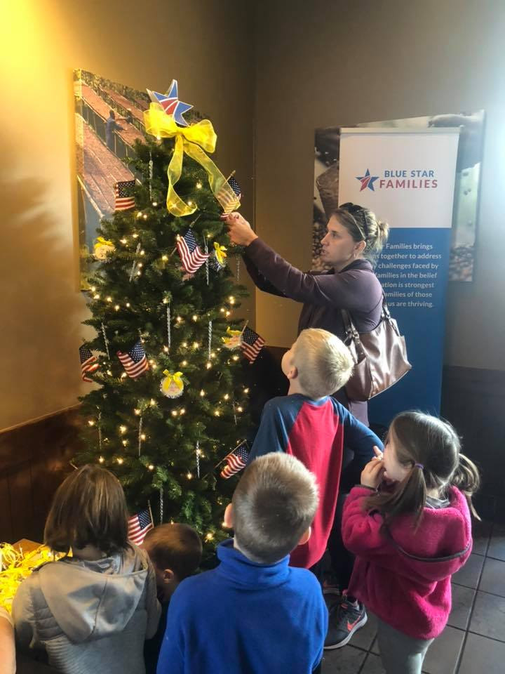 Yellow ribbon tree at Starbucks with woman and kids
