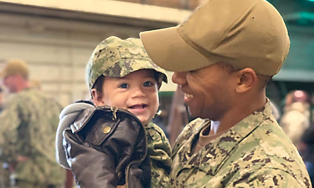 Service member and young boy