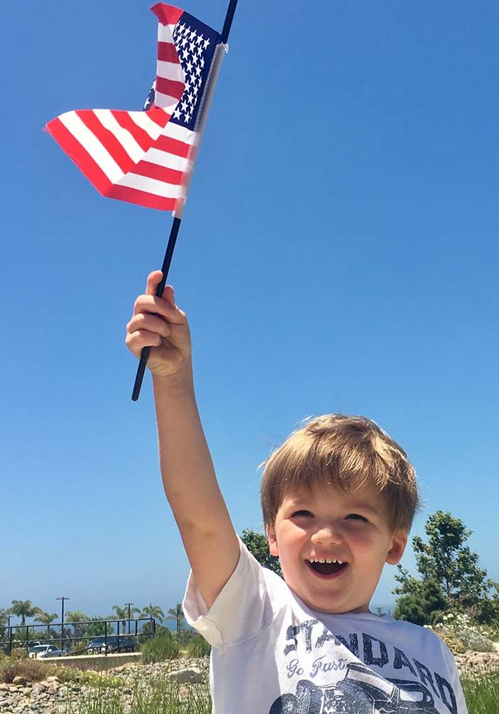 month of the military child boy holding flag photo